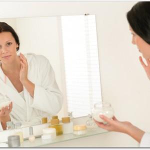 Woman facial mirror reflection in bathroom